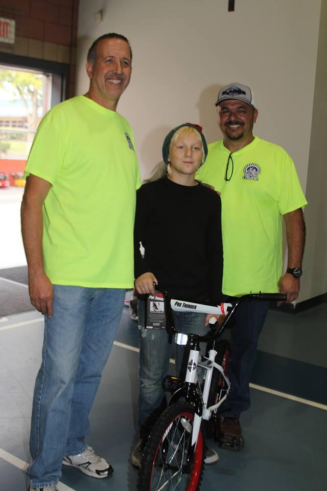 Mr. Corona and I giving away a bike